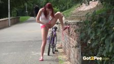 Sexy redhead babe Kattie Gold is out cycling when she feels sudden pee desp