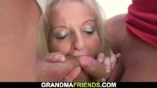 Blonde old lady takes two big cocks at once