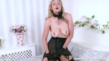 Blonde babe Sapphire Blue fingers her pussy in open girdle and sexy nylons