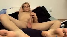 Foot worshiping twink launches a cum missile after jack off
