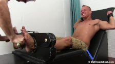 Handsome Austin Andrews bound and tickled by feet fetishists