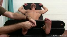 Jock on the bondage device receives freaky double tickling