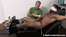 Handsome hunk tied up for tickling and cock toying