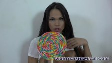 Bubble butt latina transsexual strips and strokes her cock