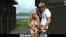 Busty 70 years old blonde granny takes cock in the changing room