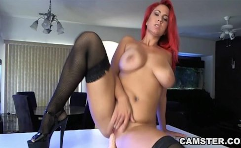 Redhead w/ big tits masturbates in kitchen |23,653 views