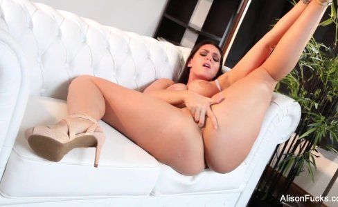 Alison Tyler fingers her pussy on the couch|22,792 views