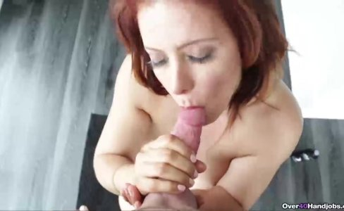 Redhead milf jerking a young guy's cock|40,291 views