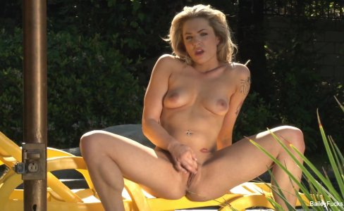 Blonde babe Dahlia Sky plays with herself outdoors|240 views