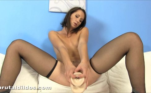 Gorgeous brunette in stockings riding a big brutal dildo|12,346 views
