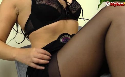 Horny brunette in black pantyhose shows feet|9,795 views