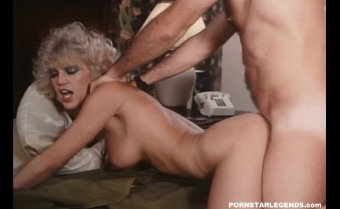 Amber Lynn double fucked on a bed|23,743 views