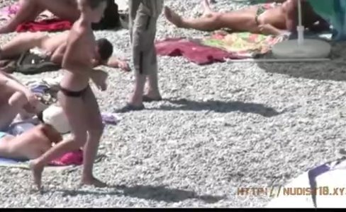 Teeny girls have fun at the nude beach|15,562 views