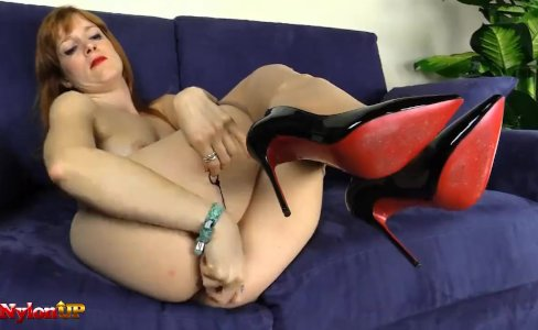 Footjob by a redhead wearing only tan pantyhose|11,275 views