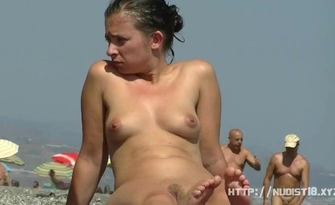 Nudist video at the beach has shy girl playing in the water|346 views