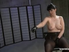 Helpless slave covered in hot wax by Mistress