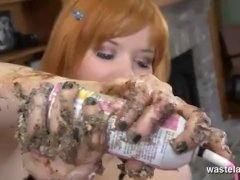 Kinky sex slave covered in cream and frosting