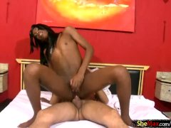 Redhead ebony shemale poses on bed and jerks
