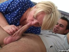Young guy helps old granny