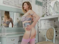 Blonde Lotti Rose performs strip tease in lingerie pink nylons flash pussy
