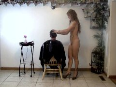 hairstylist doing a mens haircut in the nude
