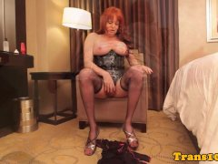 Ginger tgirl in linger uses toy before anal