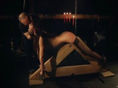 Disciplined slave trained to endure bondage submission and perform blowjob