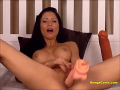 Hot brunette having the most insane squirting orgasm on her webcam