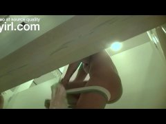 Blonde taking selfies in changing room spy cam
