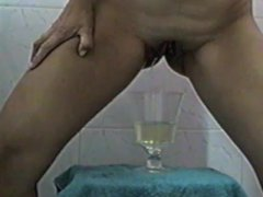 Preciosa latina mexicana peeing, pissing cup close up hairy shaved pussy