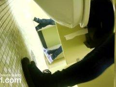 College bathroom under the stall peek