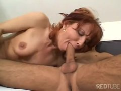 Redhead MILF gets a cock surprise