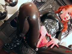 Red lubes up her latex catsuit and rubs her juicy wet pussy