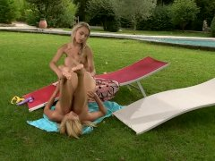 Blonde sunbathing vixens engaging in Hot Lesbian Sex
