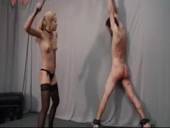 Slave getting whipped by blonde mistress