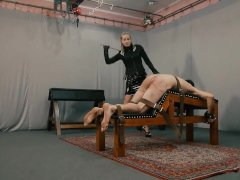 Slave getting caned by hot blonde mistress in leather