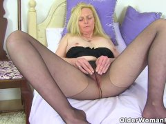 British, blonde and busty milf Fiona rips her tights