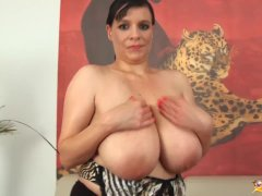 Milf shows her oiled monster boobs