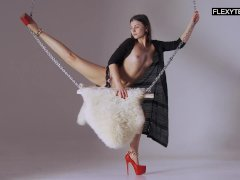 Professional gymnast from Russia doing gymnastic exercises in front of the