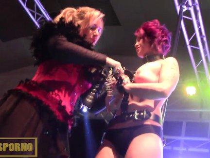 Public BDSM porno show on stage