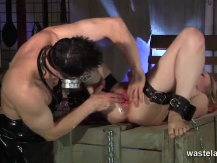 Blonde is bound in chains and fisted
