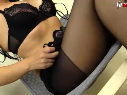 Horny brunette in black pantyhose shows feet