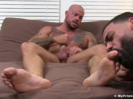 Freaky bald hunk strokes his cock while being toe sucked