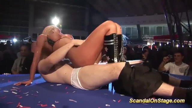facesitting on public sex fair show stage - sex video