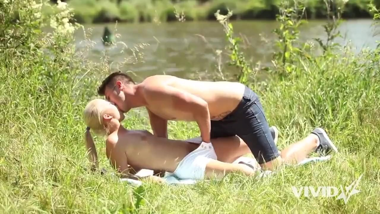 Sexy blonde girl and her man make love outdoors