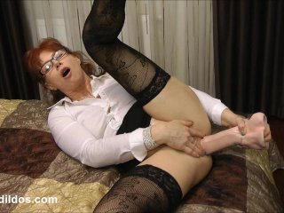 Mature secretary prolapses from dildo...
