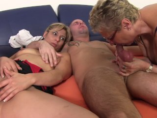 Mature horny slut sucks cock in german threesome