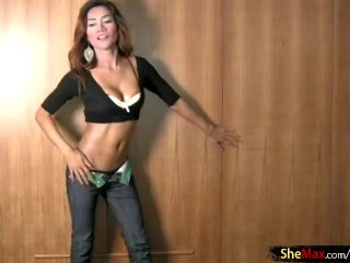 Curvy ladyboy dances relating to tight jeans coupled with fucks a carrot dildo