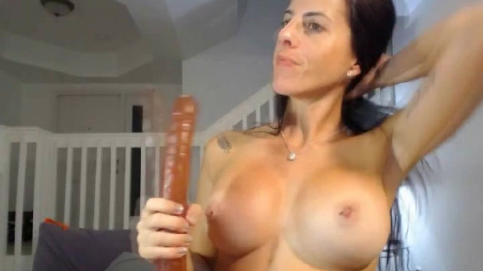 Busty Babe Rides Her Dildo on Cam