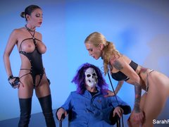 Big dick Skullman fucks two hot busty MILFs